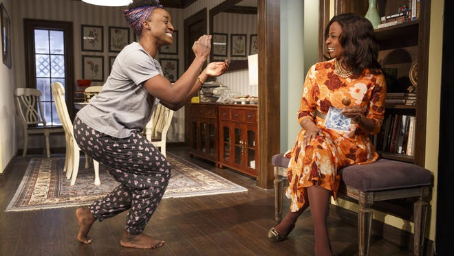 """Ito Aghayere (left) and Melanie Nicholls-King in a scene from """"Familiar."""""""