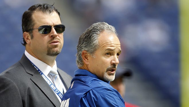 Indianapolis Colts head coach Chuck Pagano talks with Colts GM Ryan Grigson before the game. The Colts and the Dolphins warm up before first-half action at Lucas Oil Stadium in Indianapolis, Indiana, Sunday, September 15, 2013. (Sam Riche/MCT)