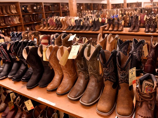 Riding and fashion boots for sale at Keith Saddle Shop in Pataskala. The business is closing after more than 50 years and has announced their going-out-of-business sale.