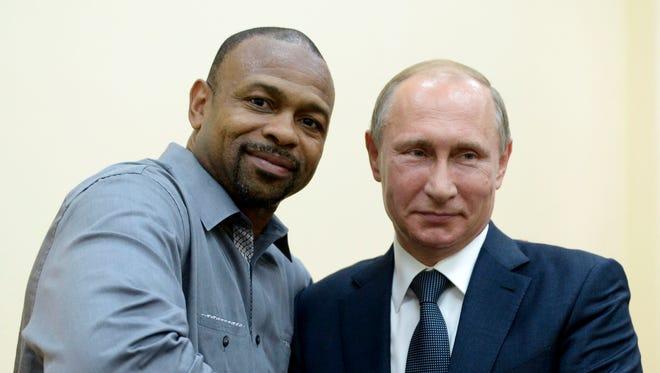 Russian President Vladimir Putin, right, meets with American boxer Roy Jones Jr. in Sevastopol, Crimea, Wednesday, Aug. 19, 2015. (Alexei Nikolsky/RIA-Novosti, Kremlin Pool Photo via AP)