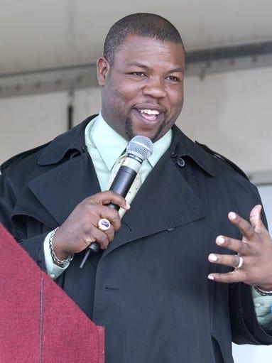 Bishop Alexis Thomas  speaks during the King Parade