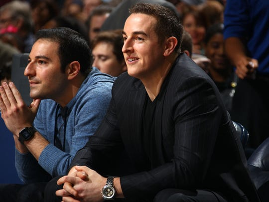 Grizzlies owner Robert Pera, right, at a December 2014 game.