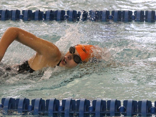 A relay member swims a leg on one of Central High School's