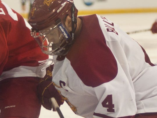 Chad Billins fights for control of the puck at the NCAA Division 1 Regional Championship Game in 2012.