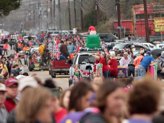 Parade-goers line Smith Street for the annual Bawcomville
