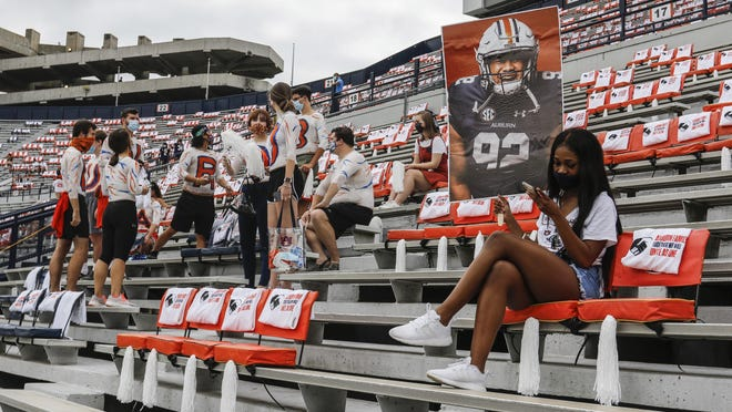 Auburn students are socially distanced as they wait the start of an NCAA college football game against Kentucky on Saturday  in Auburn, Alabama.