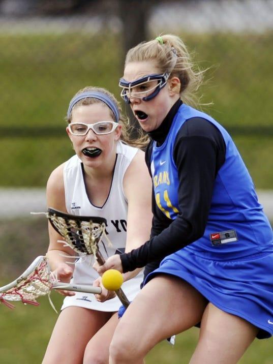 Kennard-Dale's Haley Romoser (blue) battles West York's  Kasey Miner for possession during a recent game.