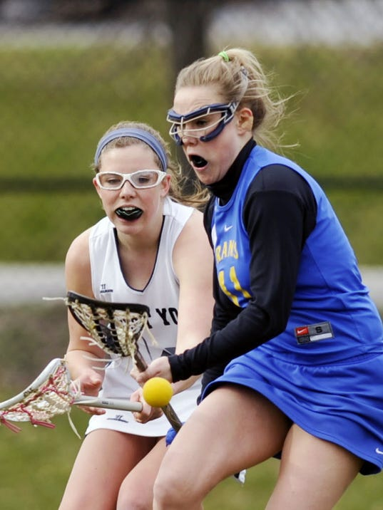 Kennard-Dale's Haley Romoser (blue) battles West York's  Kasey Miner for possession during a recent game.
