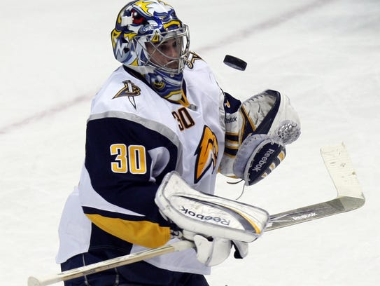 Buffalo Sabers goalie Ryan Miller makes a stop in the
