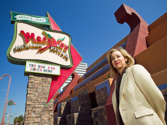 Macayo's CEO Sharisse Johnson stands outside of the Central Avenue location in central Phoenix in this file photo. The restaurant plans to move into an auto-shop building across the street.