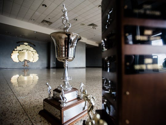 The Hanover Area Division I Cup is photographed next to the Hanover City Cup, silver trophy in background, at South Western High School. The Mustangs won more titles in both competitions than any other team.