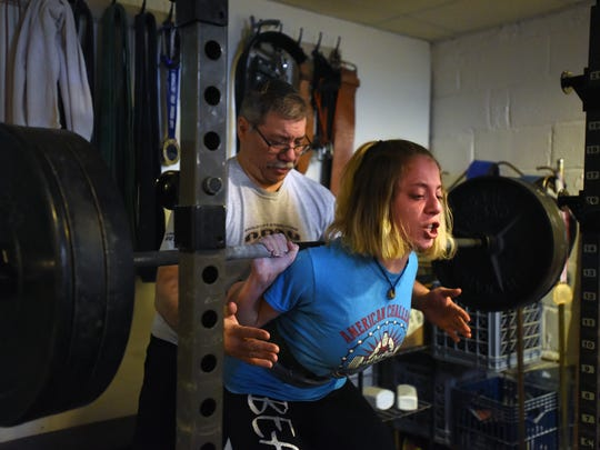 """Powerlifter Naomi """"Supergirl"""" Kutin, 15 practices in the basement of her Fair Lawn home coached by her father Ed Kutin. In competition, Kutin competes in the squat, bench press and dead lift."""