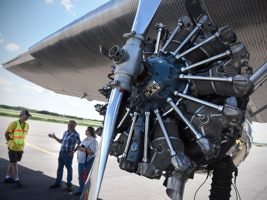 Volunteers outline the history of the  Ford Tri-Motor 5-AT Friday, July 7, at the St. Cloud Regional Airport.