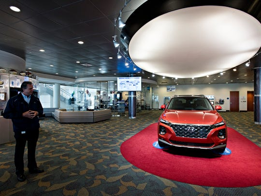 Vice President of Production Operations Chris Susock looks at a new Hyundai Santa Fe last March at Hyundai Motor Manufacturing Alabama.