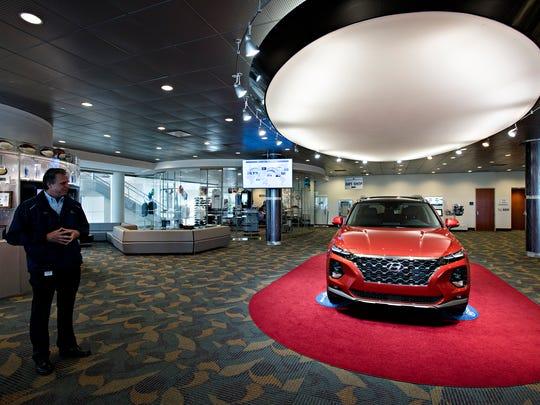 Vice President of Production Operations Chris Susock looks at a new Hyundai Santa Fe last March at Hyundai Motor Manufacturing Alabama.