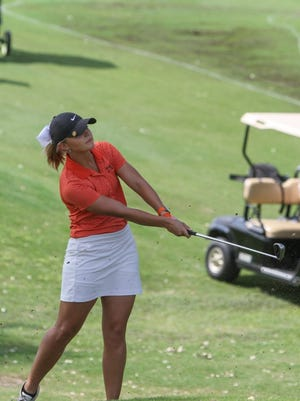 Lauren Roberts/Times Record News Petrolia's Breanna Smith hits out of the rough onto the green Monday, April 25, 2016, during the UIL Girl's State Golf Championship at the Roy Kizer Golf Course in Austin.