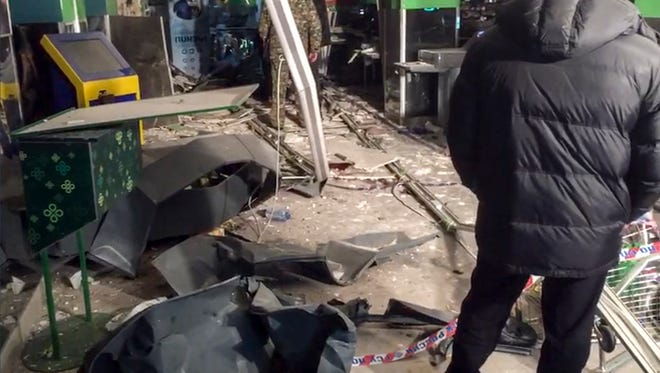 This photo provided by the Information Center of the Russian National Antiterrorism Committee shows the damage inside a supermarket after an explosion, in St. Petersburg, Russia, on Dec. 28, 2017.