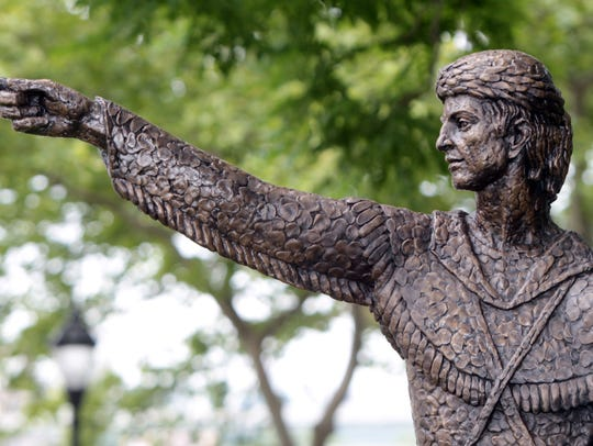 A bronze statue of Simon Kenton stands on Riverside