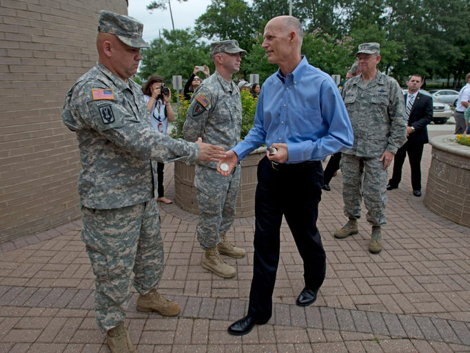 Gov. Rick Scott greets members of the National Guard while visiting the Escambia County Emergency Operations Center Monday morning June 2, 2014. Scott was in town to help remind area residents to be prepared for hurricane season, which began on Sunday June first.