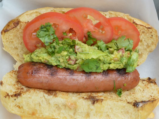Guac and tomatoes give this dog a Tex-Mex accent.