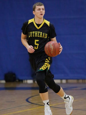 Sheboygan Lutheran's Jared Jurss (5) dribbles the ball downcourt against Howards Grove on Friday.