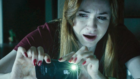 Karen Gillian looks terrified in a scene from 'Oculus.'