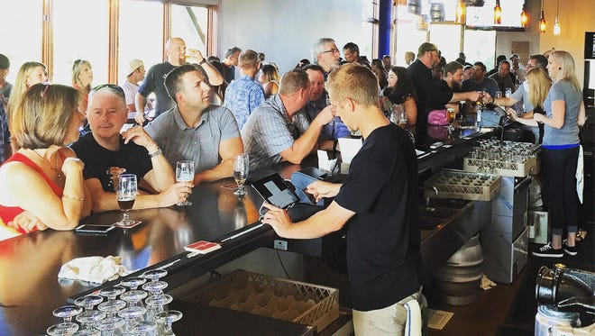 Beer NV, a new taphouse in South Creek, was packed with people on its grand opening Aug. 11.