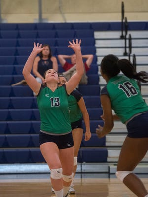Pensacola State College setter, Kaitlin Grote and DD Green (16) have helped the Pirates race to a 20-2 record that is the best of any JUCO volleyball team in the state.