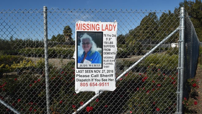 A sign hangs at Lewis Road and Highway 118 asking for the public's help in finding Somis resident Judy Wurtz. She was found Wednesday.