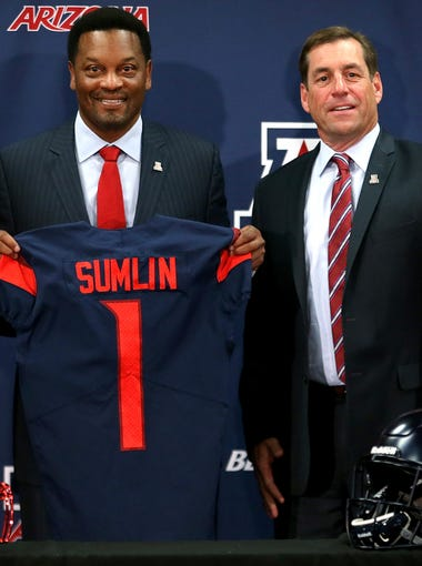 New Arizona Wildcats head football coach Kevin Sumlin poses with UA president Robert Robbins and athletic director Dave Heeke at the Lowell-Stevens Football Facility on Jan. 16, 2018, in Tucson, Ariz.
