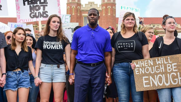 Tallahassee mayor Andrew Gillum marches with Florida