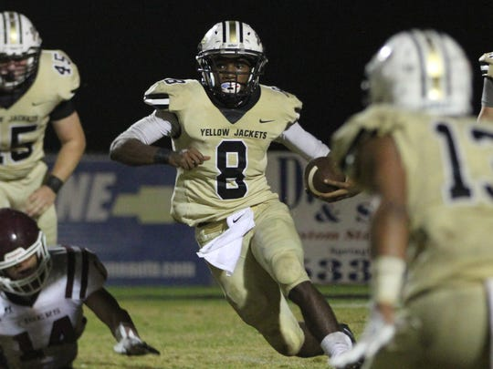 Springfield running back Keith Jones carries the ball for the Yellow Jackets during their 20-10 win over Hardin County.