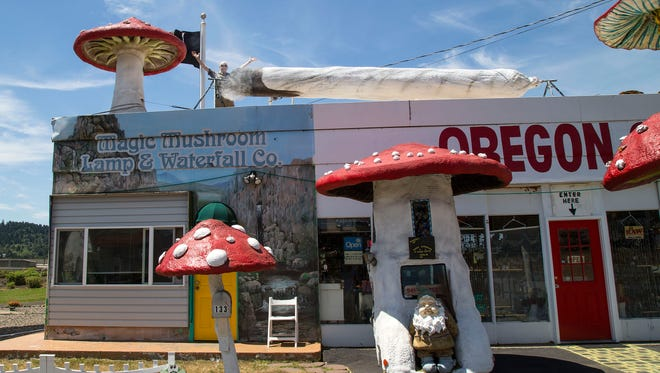 In honor of the legalization of marijuana in Oregon, Harry Pinsent, owner of the Magic Mushrooms gift shop in Sutherlin, Ore., crafted a 27-foot faux marijuana joint, which he placed on top of his shop for travelers on Interstate-5 to see, Monday, July 6, 2015. From inside the shop, Pinsent can press a button to release the smoke, according to The Register-Guard. (Julia Reihs/The Register-Guard via AP)
