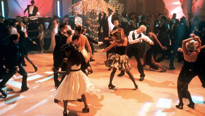 """The students of fictional Harrison High rock out at their senior prom in the movie """"She's All That."""""""