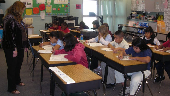 In this news-press.com file photo, students practice for their reading and writing portion of the FCAT.