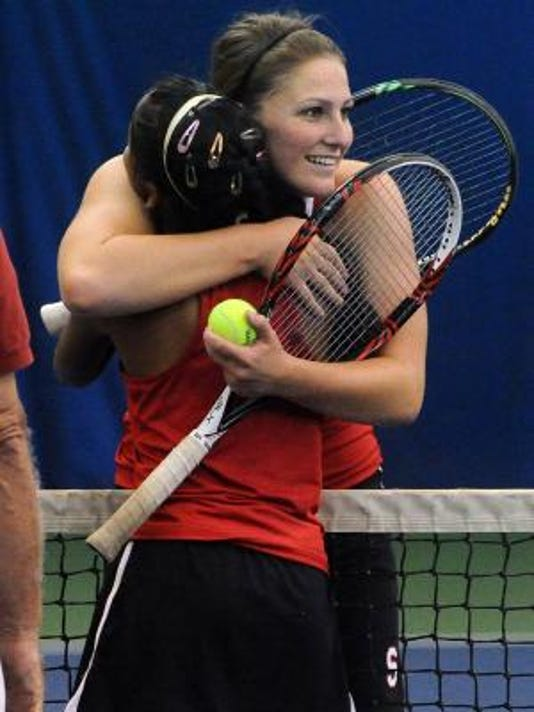 Susquehannock teammates Katie Wagner, facing camera, and Usha Baublitz embrace following their match which saw Wagner win the YAIAA AAA singles championship at Wisehaven Tennis Center on Monday, Oct. 7, 2013. (Jason Plotkin - GameTimePA.com)