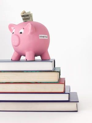 Piggy bank on stack of school books