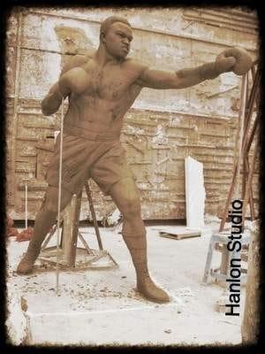 clay figure of Larry Holmes shown in Hanlon Sculpture Studio
