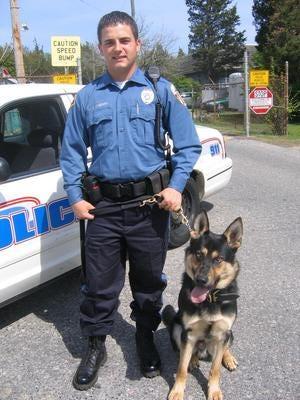 Tuckerton police Cpl. Justin Cherry with his K9 partner, Gunner.