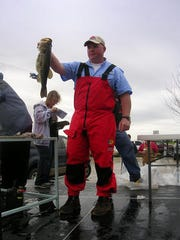 Caddo Lake guide Randy Deaver holds up a bass he caught in a past tournament.