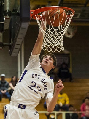 Cut Bank's Seth Omsberg dunks the ball during the Northern B Divisional game against Poplar at Cut Bank High School Thursday.