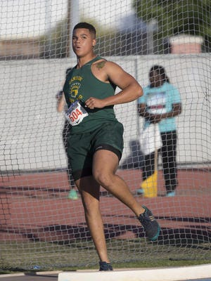 Canyon del Oro senior Turner Washington broke his own state record in the discus at the Arcadia Invitational.