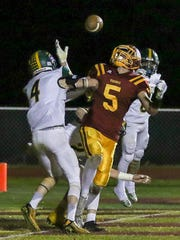 Voorhees' Jack McCabe (5) has a pass broken up in the end zone by North Hunterdon defenders Kyle Connover (left) and Connor McMahon on Friday, Nov. 3, 2017 in Glen Gardner.