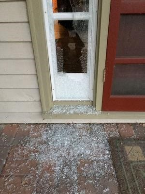 William Sivy returned to his home in the Lakes of Northville subdivision one day last October to find this window shattered, apparently by a stray bullet that township officials believe came from the nearby Michigan State Police firing range.