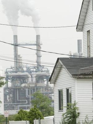 The Bayway Refinery, seen from Gilchrist Avenue in Linden, borders a large residential area.