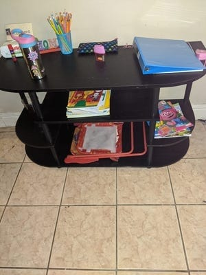 Shari Loveless, of Lancaster, Pennsylvania, improvised on a setup for her daughter Aubrianna, who is starting kindergarten virtually. Loveless said she searched for desks at Walmart, Amazon, Target and Wayfair but found only pricey desks several of which wouldn't be delivered until October. Instead, she turned a TV stand a friend was selling into a desk.
