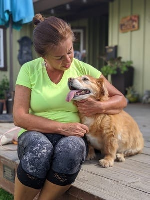 Sara Maicon with her dog, Maggie, a dog she had to surrender to a senior dog sanctuary in San Diego County.