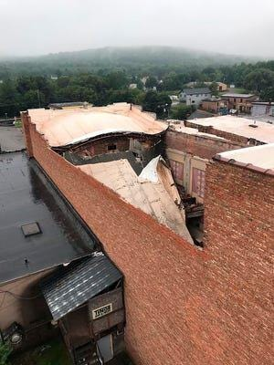 """This undated photo provided by the City of Negaunee, Mich., shows the collapsed roof at the 94-year-old Vista Theater in Negaunee. The roof at the theater likely collapsed Wednesday, Aug. 26, 2020, because of a drain failure while rain fell. Diane Darlington of the Vista Theater Advisory Board said she hopes to """"have a solution as soon as possible."""" The Vista, which offers movies and live theater, opened in 1926. Local residents formed the Peninsula Arts Appreciation Council in 1973 and took over operations."""