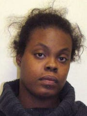 Latia Harris is seen  in an undated photo provided by the Salem County Police Department. Police in southern New Jersey are looking for Harris, who was videotaped beating a mother in front of her toddler on Tuesday, June 24, 2014. As bystanders watched and some recorded it on cellphones, the woman is shown pummeling the mother in the face and kicking her in the back along a trail in Salem on Tuesday night. Police Chief John Pelura III said Friday that police have been in contact with the family of 25-year-old Latia Harris, and were told the family is pleading with Harris to surrender. Police Chief John Pelura III said Friday that police have been in contact with the family of 25-year-old Latia Harris, and were told the family is pleading with Harris to surrender. (AP Photo/Salem County Police Department)
