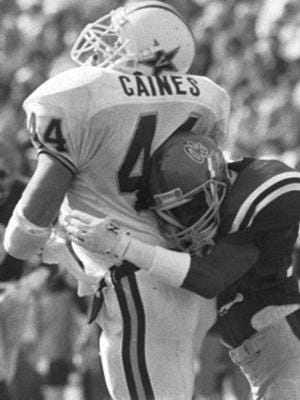 Ole Miss' Chucky Mullins, left, was paralyzed after making this hit on Vanderbilt's Brad Gaines during a game in 1989.